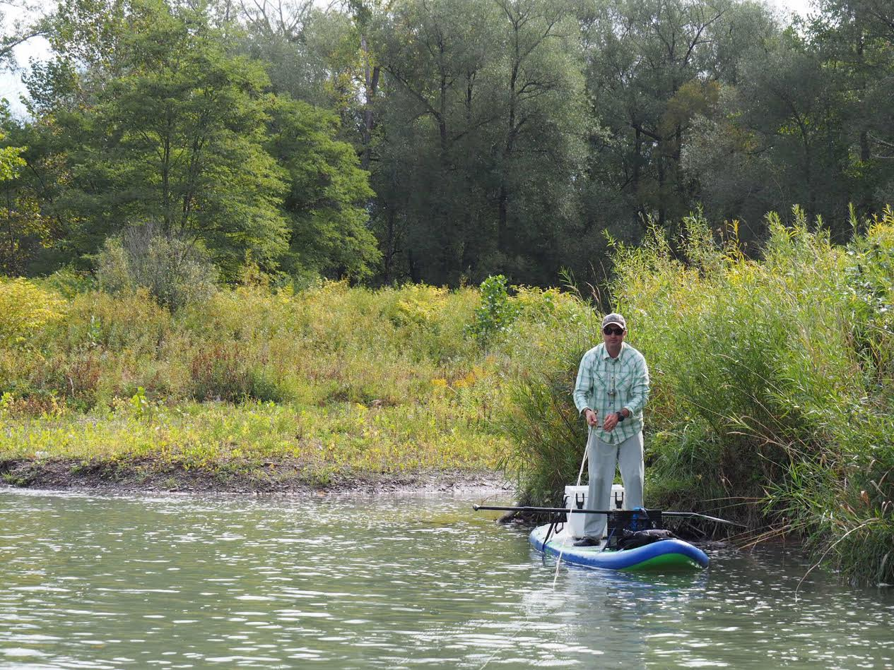 Damon newpher sup on the fly for What is fly fishing